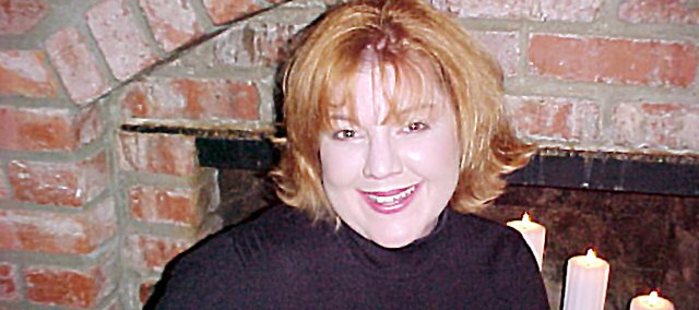 """Glenna Thompson, who was raised in Baldwin City, had her book """"The Chicken Club"""" (inset) published last month. Her second book is to be published in September."""