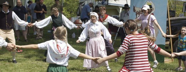 Performers from Lindsborg Folkdanslag, a Swedish folk dance group, join with visitors to form a dance circle Saturday at the Kansas Sampler Festival at Ray Miller Park in Leavenworth.