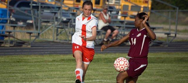 Alyssa Miller kicks the ball past a Kansas City-Washington defender Monday afternoon. Tonganoxie High, led by Miller's two goals, beat Washington, 5-1.