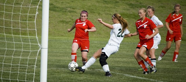 Tonganoxie High's Molly Welsh battles Basehor-Linwood's Melissa Seaman for the ball right in front of the goal Tuesday evening at BLHS. The Chieftains won their regular-season finale, 2-1.
