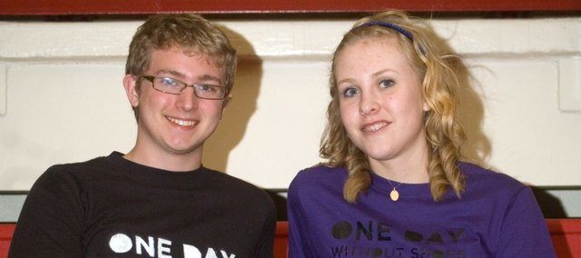 Tonganoxie High School students Aaron McIntyre and Jody Baragary organized A Day Without Shoes similar to the national day TOMS shoes organizes to bring awareness about children around the world who are without shoes. The students also had T-shirts on hand for students to purchase for the day. They raised more than $350 through the drive.