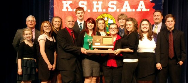 The Tonganoxie High School forensics team finished 2nd at state. Pictured front row, from left, Halston Field, Madison Derry, Elliott Brest, Megan Woods, Miranda Bontrager, Laura Dyster, Beth Jobst and Michael Christensen; back row, from left, Ken Church, Parker Osborne, Dane Erickson, Hunter Cook, Brady Field and Steve Harrell.