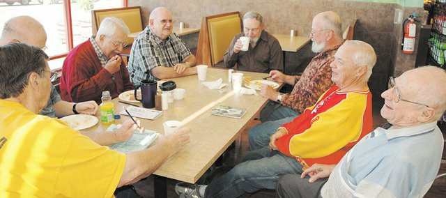 Members of the new men's group at the Bonner Springs Senior Center meet for breakfast Friday at the Bonner Springs Price Chopper. From right are Howard Reitzel, Phil Hutchinson, Ed Mellott, Burt Burton, Charles Knapp, Mike Everett and Larry Hitchcock.