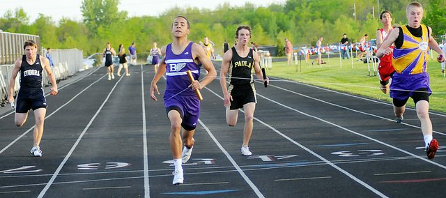 Baldwin High School senior Asher Hannon,, center, crosses the finish line to win the 400-meter relay Friday night. Hannon also anchored the 1,600-meter relay which won its race, too. In his individual events, Hannon finished third in the 100-meter dash and runner-up in the 400-meter dash. He ran his fastest time in both races.