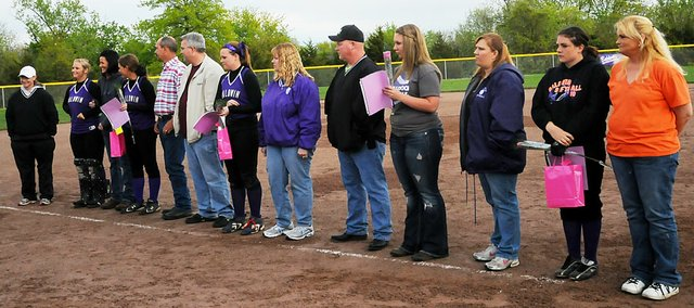 Baldwin High Schools softball team celebrated its senior night last Thursday after its doubleheader against Paola was rained out. The BHS seniors, from left with their parents, are Kyla Good, Aspen Brooks, Morgan Burton, Kelsi Burton and Karlee Beach. 