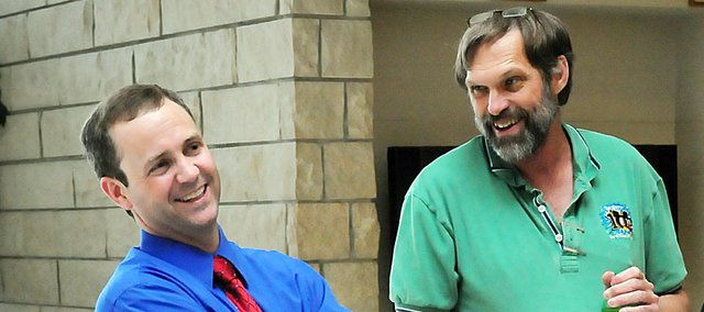 Rob McKim, left, shares a laugh with Baldwin High School math teacher Mike Curran during McKim's first visit last week to the high school after being hired as the school's new principal. McKim, currently an assistant principal at Fort Scott High School, is a native of Sabetha.