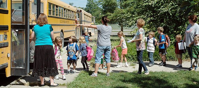 The USD 348 Board of Education rejected a recommendation by the transportation committee to cut busing to all students inside the city limits. It was a unanimous vote Monday night.