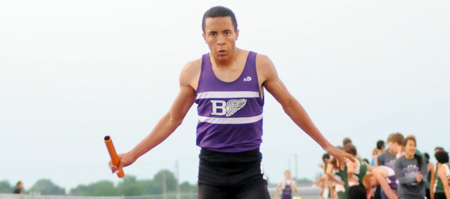 Baldwin High School senior Asher Hannon wins the 1,600-meter relay Thursday evening in Eudora. The Bulldogs ran 3:26.02 to set a new league meet record. Joining Hannon on the relay were senior Carson Barnes, junior Tosh Mihesuah and junior Brian Wright.
