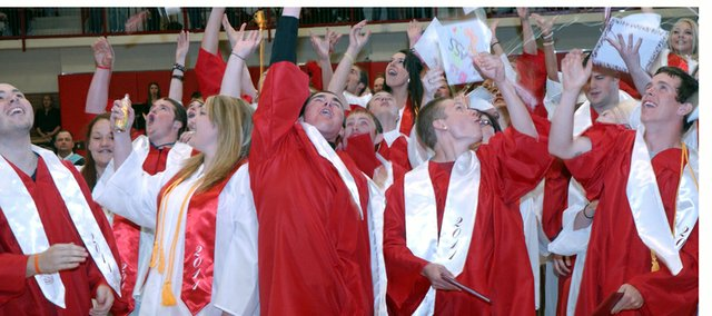The Tonganoxie Class of 2011 explodes in celebration at the conclusion of Saturday&#39;s graduation.