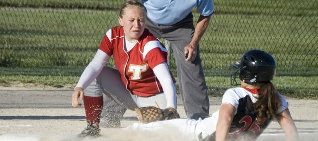 Tonganoxie High third baseman Amanda Holroyd tags out a Jeff West runner in the fourth inning of the Chieftains' 17-8 first-round playoff win on Monday at Field of Dreams.