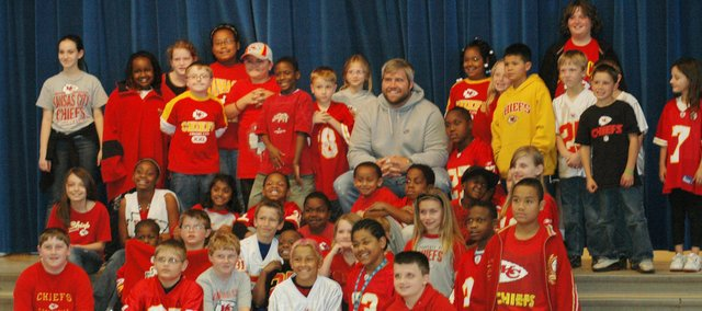 Kansas City Chiefs offensive lineman Ryan Lilja is surrounded by Broken Arrow Elementary students wearing Chiefs apparel. Lilja visited his former school Monday.