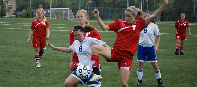 Tonganoxie High freshman Emily Soetaert jumps in to try and take control of the ball against Kansas City Christian's Christine Kucera in the first half of a regional title game Thursday at Overland Park Soccer Complex. The Chieftains' season ended with a 4-0 loss.