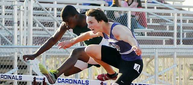 Baldwin High School senior Carson Barnes, right, narrowly leads De Soto's Jeff Bowen down the home stretch of the 300-meter hurdles at the Frontier League meet last Thursday. Barnes won the race in a time of 40.42 seconds.