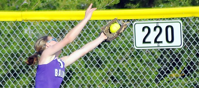 Baldwin High School sophomore Kaitlin Jorgensen makes a running catch near the center field wall Tuesday during the Bulldogs' regional contest against Saint James Academy. The Bulldogs lost the game 3-2, which ended their season with a 13-9 record.
