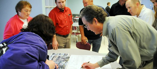 Douglas County Director of Public Works and County Engineer Keith Browning, right, talks with Baldwin City patrons about the North Sixth Street Project at the April 28 public meeting.