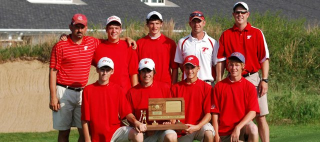 The Tonganoxie High golf team poses with its trophy after finishing second at the Class 4A state tournament at Hutchinson on Monday. The Chieftains won their first state trophy in program history in just their second state appearance after posting a four-player score of 332 at Prairie Dunes Country Club. Pictured are: (front row) Drew Sandburg, Colby Yates, Tyler Hall, Kody Campbell, (back row) assistant coach Doug Sandburg, Tanner Hale, Aaron Williams, head coach Jared Jackson and assistant coach David Walker.