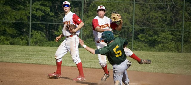 Tonganoxie High senior second baseman Dylan Puhr hangs in to turn a double play as Basehor-Linwood's Brett Bailes slides into second in a regional semifinal game on May 17 at Ozawkie. BLHS won, 11-8, in nine innings.