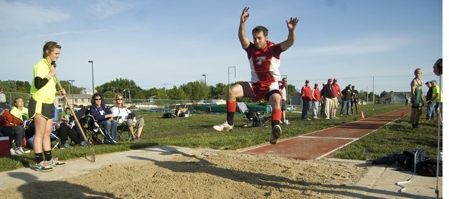 Tonganoxie High senior Dylan Scates nears completion on a regional championship triple jump on Friday at Basehor-Linwood. Scates was one of 10 THS athletes to earn a trip to state with a top-four finish at a Class 4A regional meet.