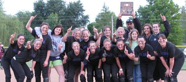 The McLouth High softball team poses with its regional championship plaque after defeating Silver Lake, 3-2, in a Class 3A regional title game on May 17 at SLHS. With the victory, the Bulldogs will return to the state tournament for the first time since 2008.