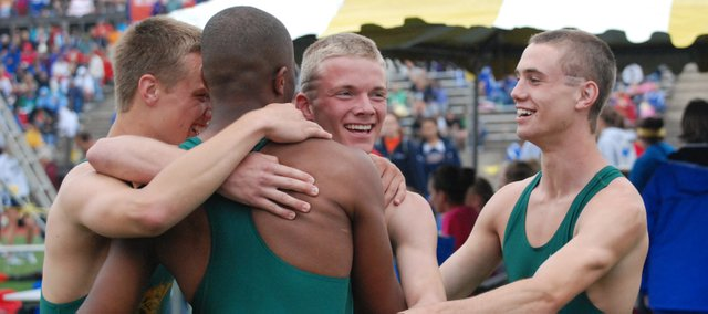 The Basehor-Linwood boys 400-meter relay team celebrates after winning the Class 4A state championship Friday, May 28, 2011.