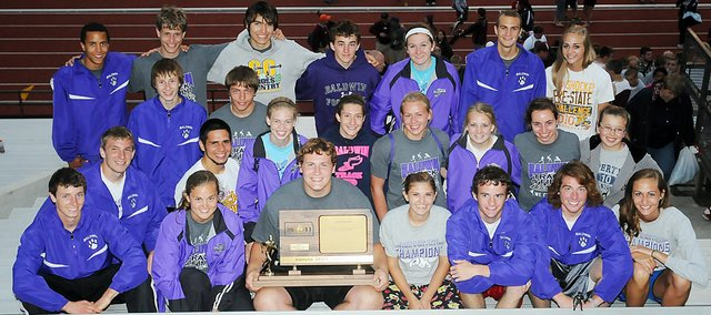 Baldwin High School's track and field teams won the Class 4A state championships Saturday May 28 in Wichita. Both teams tied for the state titles and brought home one trophy after each team coin flipped to see who took home the trophies. The boys tied with Louisburg and the girls tied with Colby.
