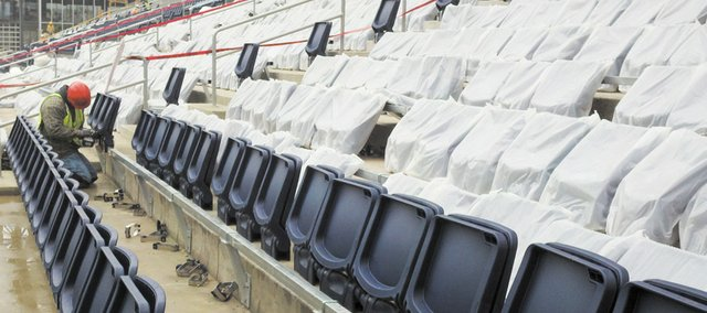 A worker installs seating in the new LIVESTRONG Sporting Park in Kansas City, Kan. The new, $200 million stadium opens this month as the home of soccer's Sporting Kansas City club.