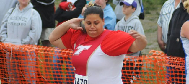 Tonganoxie High senior Domino Grizzle rotates in preparation of a shot put Saturday morning at the state track meet in Wichita. Grizzle took second place in shot with a throw of 40 feet, 9.5 inches.