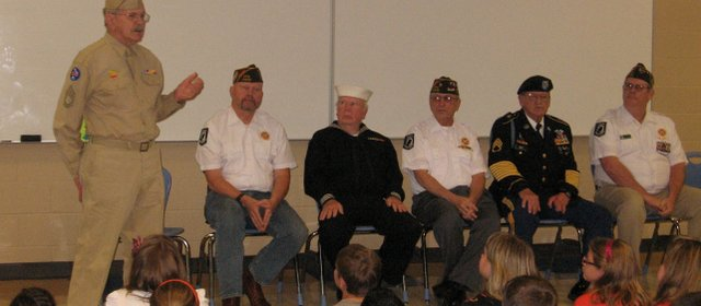 Basehor VFW Post member Wilbur Grisham, a World War II Army veteran, speaks to Basehor Intermediate School students Friday, May 27.