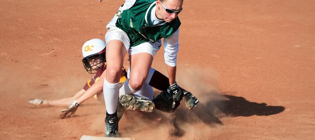 Hannah Tush, Basehor-Linwood junior shortstop, puts a tag on a Girard runner during the Bobcats' Class 4A state tournament opener Friday in Salina. Girard edged BLHS 2-0. View a photo gallery from the game at nickverbenecphotography.com.