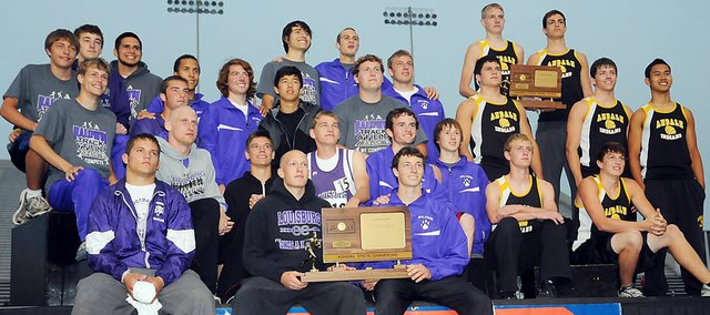 The Baldwin High School boys' track and field team won the Class 4A state championship Saturday in Wichita. The Bulldogs tied with Louisburg for the title. Andale finished third as a team. The three teams are shown on the awards stand at the conclusion of the meet.