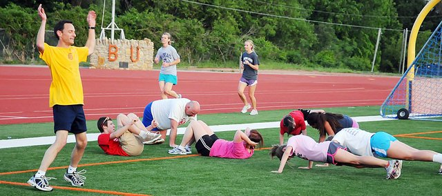 Participants at Bulldog Days work out at Liston Stadium last week. The 30-minute free workout program is back this summer.