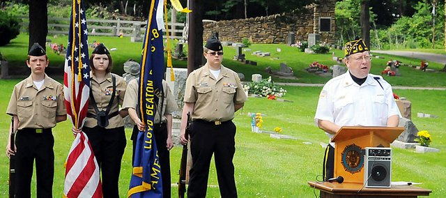 Chuck Shoemaker, member of American Legion Post 370 in Overland Park, speaks to the audience at the Memorial Day Ceremony at 10 a.m. Monday at Oakwood Cemetery. The ceremony also included the ringing of the bell for verterans who have died and the playing of taps.­