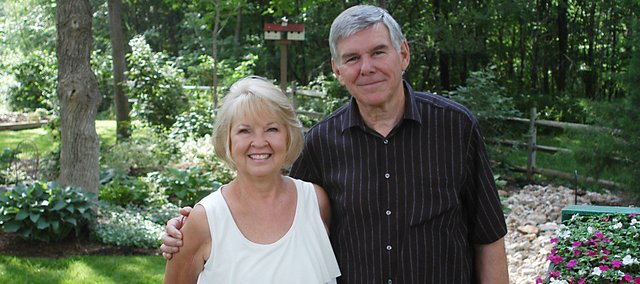 Elaine and Richard Jones' garden will be among those open to the public Saturday during the Shawnee Garden Sampler Tour. The landscaping includes many shade-tolerant plants and salvaged objects the Joneses found while traveling, such as the Mexican fruit cart next to the couple.