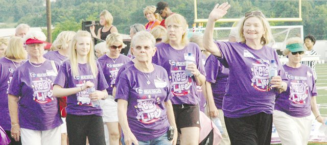 Survivors take to the track in last year's Kaw Valley Relay For Life. This year's event already has reached the goal of raising a cumulative $1 million over its history.