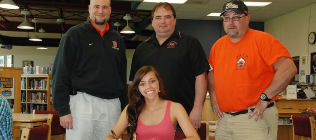 Erica Smith, Bonner Springs High School senior, recently signed a letter of intent to play basketball at Fort Scott Community College. Pictured at the signing ceremony are, seated: Erica Smith; and standing, from left: BSHS athletics director John Hilton, BSHS coach Clay Oakes and father Eric Smith. Mither Fawn Smith is not pictured.