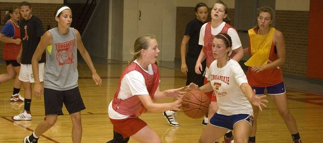 Tonganoxie High guard Alissa Donnelly makes a pass while being defended by Hannah Kemp Thursday at THS girls basketball camp. The Chieftains had 21 players participate in the four-day camp June 6-9.