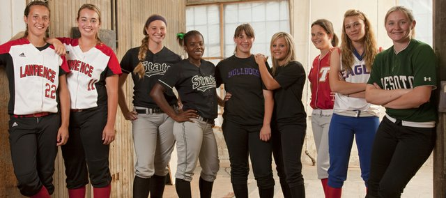The All-Area softball first team, from left, is: Kristen Bell, Lawrence High; Lauren Massey, Lawrence High; Samantha OBrien, Free State; ALiyah Rogers, Free State; Kaley Patterson, McLouth; Jesse Troupe, McLouth; Kaitlyn Wolken, Tonganoxie; Elizabeth Strawn, Wellsville; Lauren Mabe, De Soto. Not pictured: Mikela Scott, Ottawa; coach of the year Reenie Stogsdill, Lawrence High.