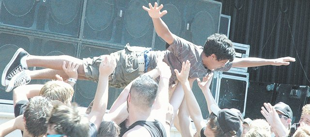 A concert attendee crowd surfs at last summer's Vans Warped Tour at Capitol Federal Park at Sandstone. The venue's promoters are working toward making this year's concert season better than last year's.