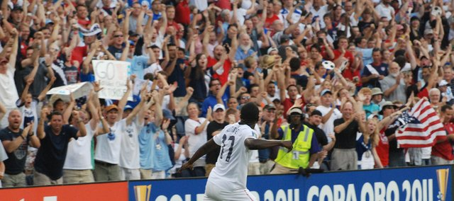 Jozy Altidore looks to a standing-room-only crowd at LIVESTRONG Sporting Park and celebrates after scoring a first-half goal in the United States' 1-0 victory against Guadeloupe.