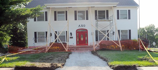 Baker University's Alpha Chi Omega sorority house is undergoing renovations this summer. Those include replacing the front porch cement floor, new windows, adding French doors and installing an underground sprinkler system to the 61-year old house.