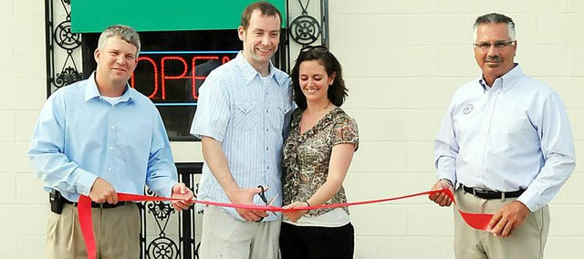 Brent Boyle, and wife Darcy, prepare to cut the ribbon at the grand opening of the Baldwin Diner June 9, while Baldwin City Chamber of Commerce members Jay Randels, left, and Greg Kruger, right, hold the ribbon. The restaurant formerly known as Cordobas changed owners and names.
