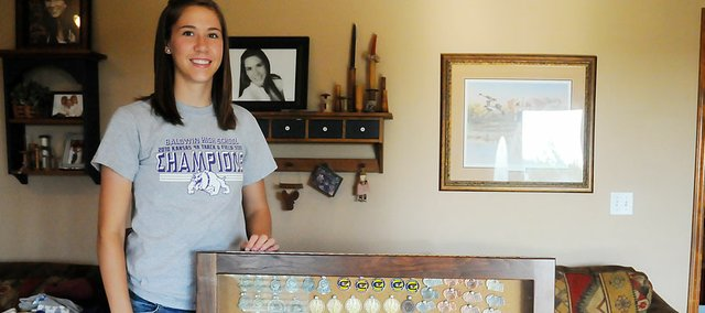 Ramie Burkhart, a 2011 Baldwin High School graduate, was chosen as the Baldwin City Signal's female athlete of the year from Baldwin High School. Burkhart excelled in all three sports — volleyball, basketball and track — during her four years as a Bulldog.