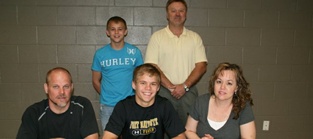 Symon Seaton, Basehor-Linwood senior, recently signed a letter of intent to wrestle at Fort Hays State University. Pictured at the signing ceremony are, from left, seated: coach and father Ed Seaton; Symon Seaton, mother Mary Seaton; and, standing: brother Sammy Seaton, and BLHS activities director Joe Keeler.
