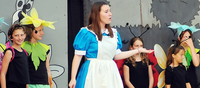 "Members of the Baldwin City Community Theater cast of ""Alice the Musical"" perform a scene during Saturday's performance."