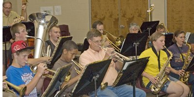 Members of Tonganoxie Community Band practice for their 2011 performance at 7 p.m. Tuesday on the stage of VFW Park.