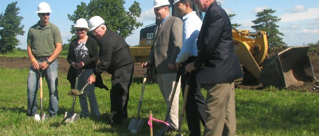 Dr. Bill Fleming unearths a clump of dirt at the ground-breaking ceremony for the Pinehurst Retail West development Wednesday, June 22. Watching on are, from left, Dan Cunningham, project superintendent for KSI Construction; Pam Fleming, Bill Fleming's wife; Mark Loughry, Basehor city administrator; Aladdin Ashkar, Basehor Chamber of Commerce president; and Steve Jack, Leavenworth County Development Corporation executive director.