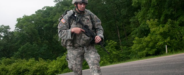 Staff Sgt. Max Rees, a native of Leavenworth, moves along in the foot march event of the Army Reserve Best Warrior Competition at Fort McCoy, Wis., on Wednesday. Rees and the other competitors carried 80 pounds of equipment and were required to move at a pace of 15 minutes per mile for the six-mile event, Rees said.