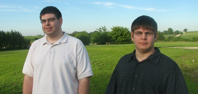 "Bryan (left) and Steven Chase, who live in rural Shawnee County about 8 miles west of Topeka, are two recent graduates of Basehor-Linwood Virtual School. Under a new graduation rate formula required by the U.S. Department of Education, though, the Chases would count as ""non-graduates,"" because they took longer than four years to finish their high school course work."