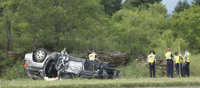 Kansas Highway Patrol Troopers work the scene of a fatality accident on U.S. Highway 24/40 in Leavenworth County on Thursday, July 7, 2011.
