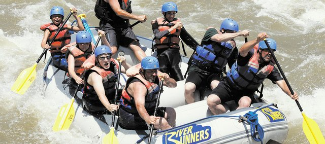 Members of Bonner Springs Boy Scout Troop No. 149 paddle through the rapids on the Arkansas River while on a camping trip in Colorado. Further downriver, after this photo was taken, the Scouts and their adult leaders helped rescue several passengers who tumbled out of another raft in their group.